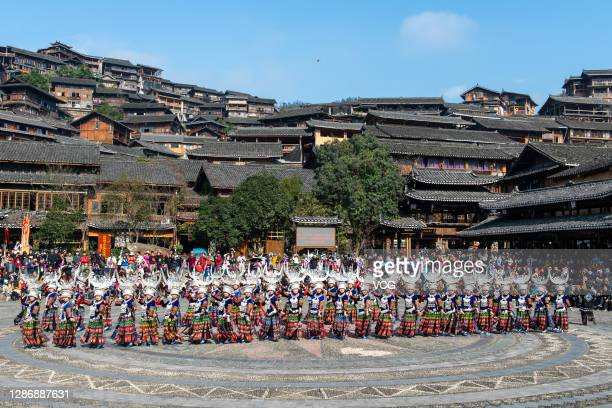 Women of Miao ethnic group weaing traditional costumes dance to celebrate the Miao New Year at the Xijiang Qianhu Miao village, which is the largest...
