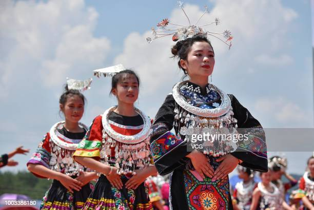 Women of Miao ethnic minority group dance to celebrate the traditional festival on the 6th day of the 6th month of the Chinese traditional lunar...