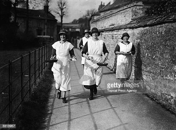 Women of Olney in Buckinghamshire running in the local Shrove Tuesday pancake race