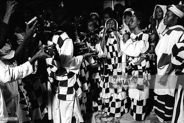 Women of the Baye Fall community sing and dance Dukat for praising Allah April 22 2003 in Mbake Senegal The Mouride Baye Fall community in Senegal...