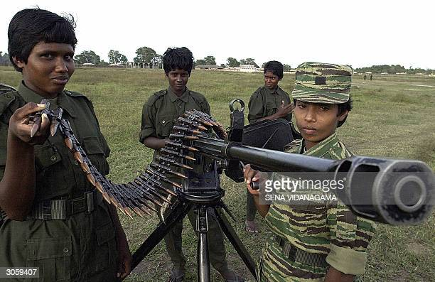 Women of the breakaway faction of Tamil Tiger rebels leaded by V Muralitharan man a gun in Batticaloa district in eastern Sri Lanka 09 March 2004 The...