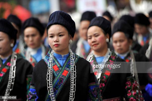 Women of the Miao ethnic minority in traditional costumes parade during their traditional Sister Festival in Taijiang county southwest China's...
