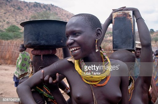 Women of the topoza tribe carrying water in southern sudan stock women of the topoza tribe carrying water in southern sudan stock photo getty images sciox Images