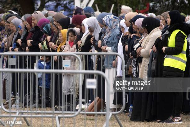 Women offer funeral prayers for those killed in New Zealand's twin mosque attacks at Memorial Park cemetery in Christchurch on March 21 2019 A...