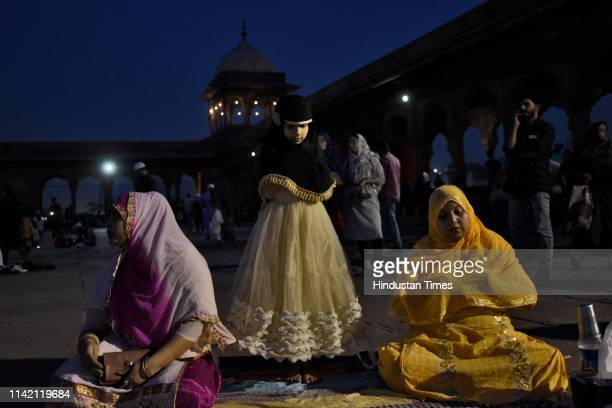 Women offer prayers after breaking their fast on the first day of the holy fasting month of Ramadan at Jama Masjid on May 7 2019 in New Delhi India