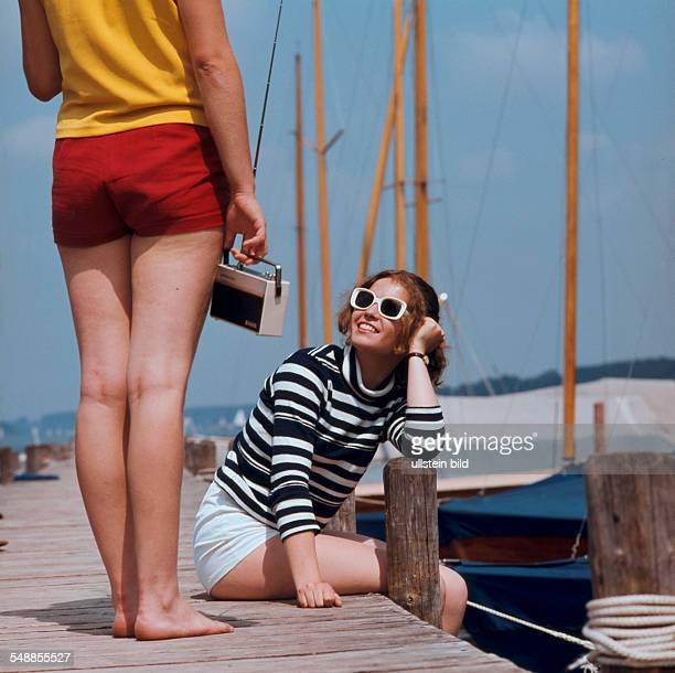 women on a pier in a marina 1970s