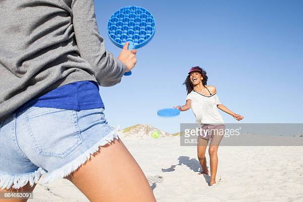 Women on beach playing tennis