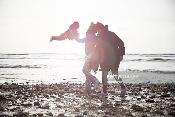 Women On Beach With  Young Boy.