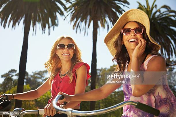 Women on bicycle laughing