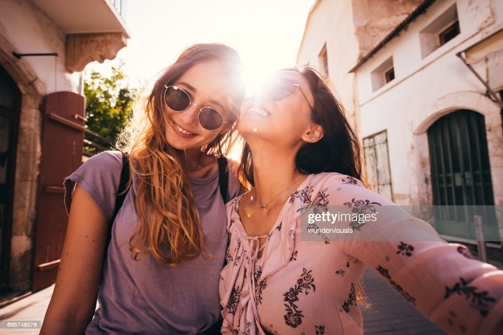 Women on Mediterranean vacations taking a selfie in a city : Stock Photo