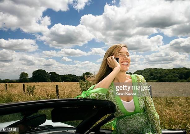 women on mobile phone, by car - アマシャム ストックフォトと画像