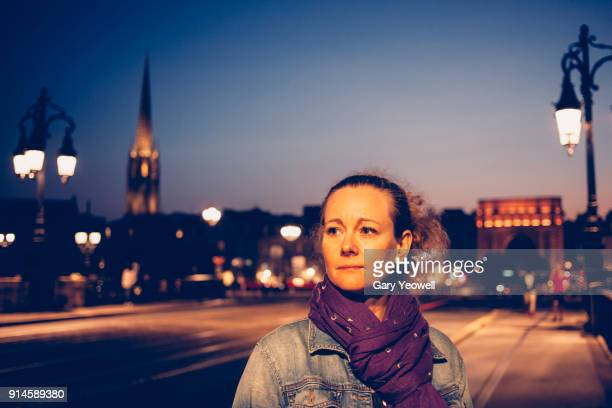 women on ponte de pierre in bordeaux at night - gironde stock pictures, royalty-free photos & images