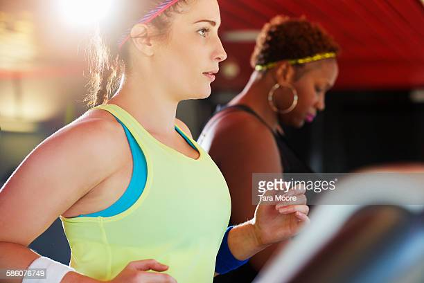 Women on running machine at the gym