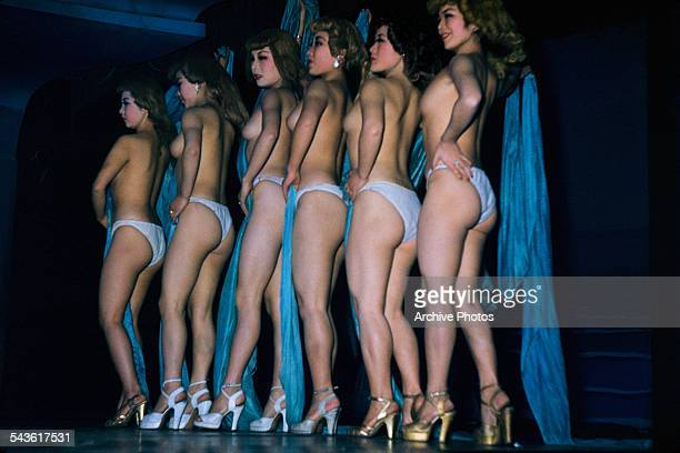 Women on stage during a topless revue show at a music hall in Tokyo Japan circa 1965