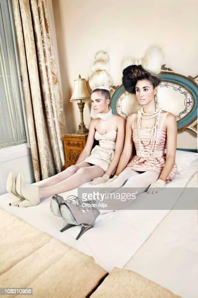 Donne sul letto