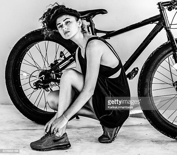 women  on the bike - white hat fashion item stock photos and pictures