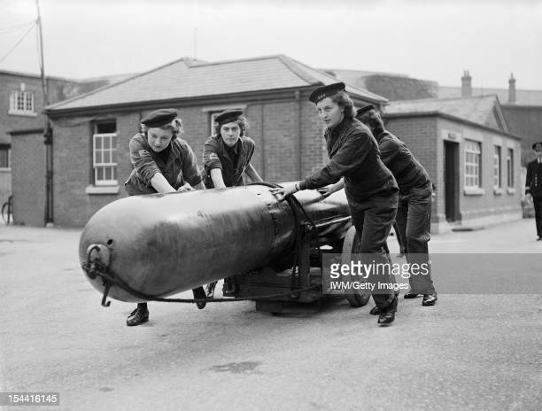 Women On The Home Front 1939 1945 The Women's Royal Naval Service A torpedo being moved by a group of four Wrens so that it could be loaded into a...