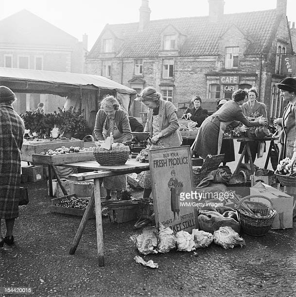 Women On The Home Front 1939 - 1945, Women in the Voluntary Services: Members of the Women's Institute selling home produce on stalls at Malton,...