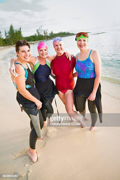 women on tropical beach - sea swimming stock photos and pictures