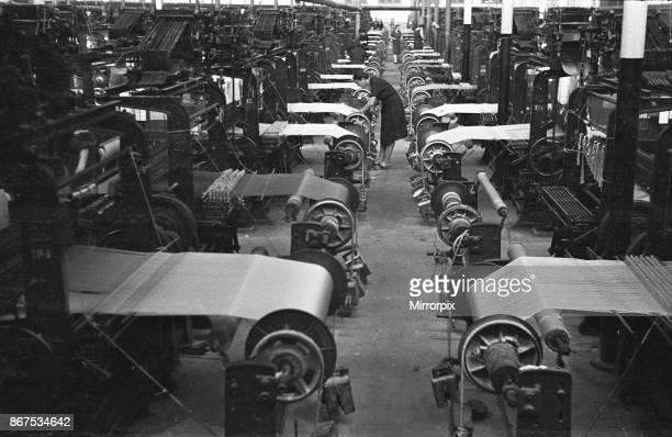Women operating looms at a Milan mill circa 1955