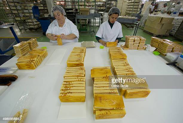 Women pack turrones de yema tostadas at the El Abuelo artisan factory on November 24 2015 in Jijona Spain Turron a nougat confection of toasted...