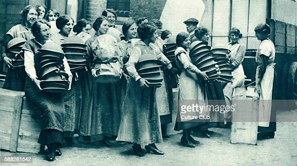 Women packing steel helmets during World War 1 Easter 1916 Packing helmets to be shipped to Western Front