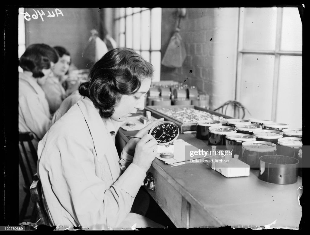 Women painting alarm clock faces, Ingersoll factory, January 1932. : News Photo