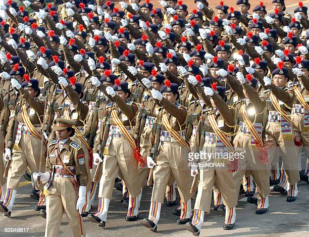 Women paramilitary members from the Central Reserve Police Force march during a full final dress rehearsal parade for India's forthcoming Republic...