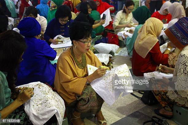 500 women participants from various community profession and organization participate in East Java batik event in Surabaya National Batik Day is a...