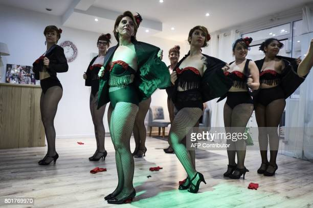Women participate in a class of burlesque striptease on June 21 2017 in Villeurbanne near Lyon eastern France / AFP PHOTO / JEANPHILIPPE KSIAZEK
