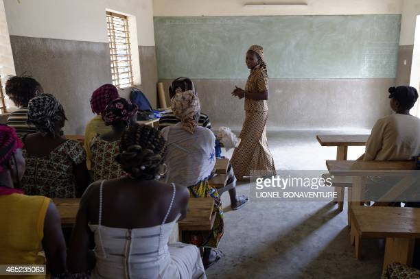Women participate in a lesson at a literacy center in Leo southcentral Burkina Faso on January 24 2014 French cosmetics company L'Occitane has been...