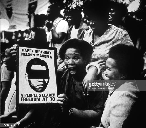 Women participate in an illegal rally at Western Cape University in celebration of the 70th birthday of imprisoned anti-apartheid leader Nelson...