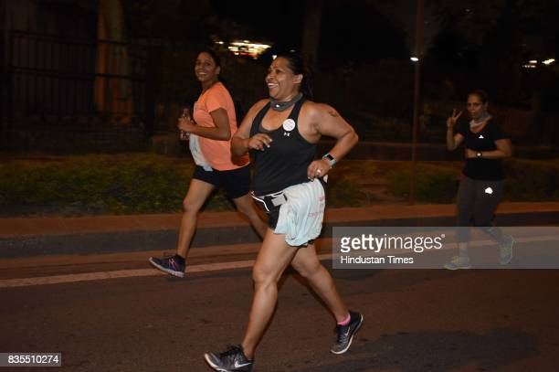 Women participate in Colors Pinkathon Delhi 'Fearless Midnight Women's run' along with Delhi Police as one of the participants organised at Inner...