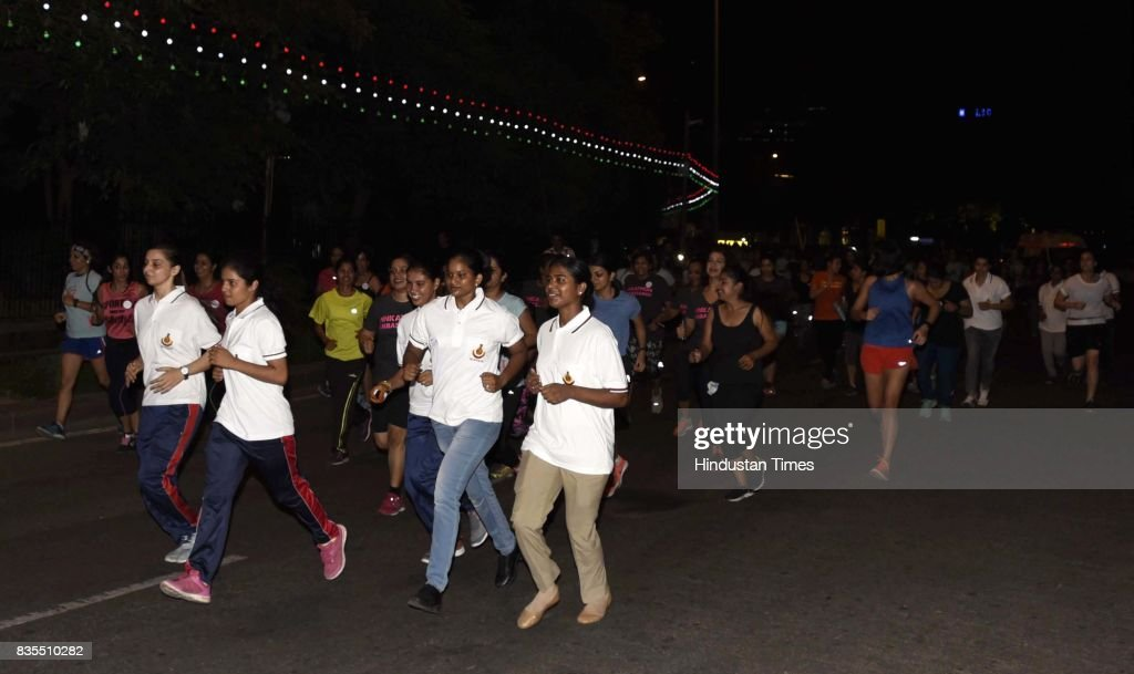 Women participate in Colors Pinkathon Delhi, 'Fearless Midnight Women's run', along with Delhi Police as one of the participants, organised at Inner Circle, Connaught Place, on August 18, 2017 in New Delhi, India. The run was not a protest or a fight, but through this midnight run, hundreds of women proved solidarity and fearlessness. 'Fearless' is an endeavour to help women to make a strong statement about their right to reclaim spaces.