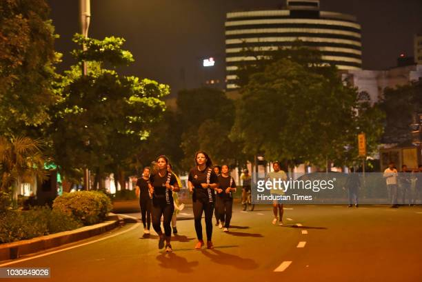 Women participate in The Fearless Run a midnight run of 5 kilometers which was organised in the presence of Delhi Police officials in the capital at...