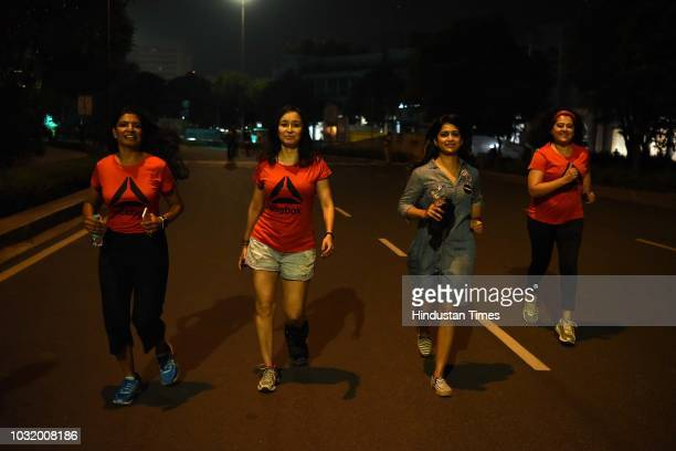 Women participate in the The Fearless Run a midnight run of 5 kilometers which was organised by the Delhi Police in association with the NGO United...