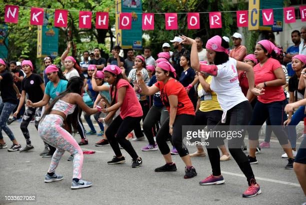 Women participate in zumba aerobics and salsa for awareness session to promote healthy lifestyle for women Pinkathon in Guwahati Assam India on...