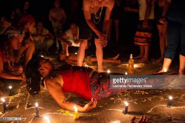 Women participates in a healing ritual called Velación at night during a spiritual ritual in a portal in the mountain of Maria Lionza at Sorte on...