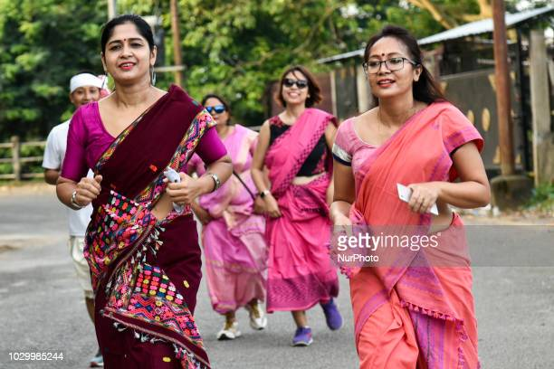 Women participating in a Temple to Temple Run event held as a tribute to womanhood organized by Pinkathon The run start from Shri Shri Nabagraha...