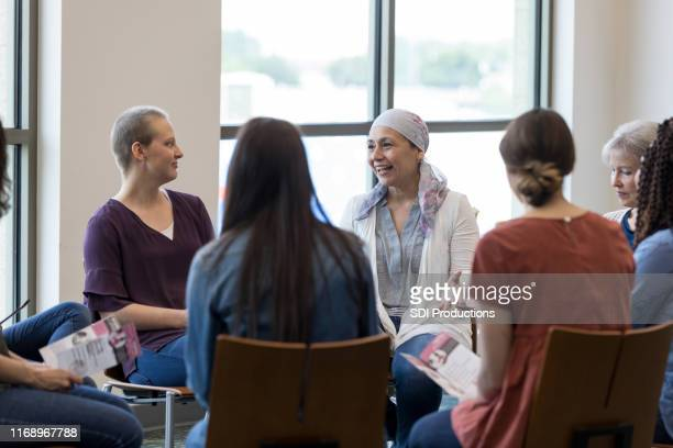 women participating in support group - survival stock pictures, royalty-free photos & images