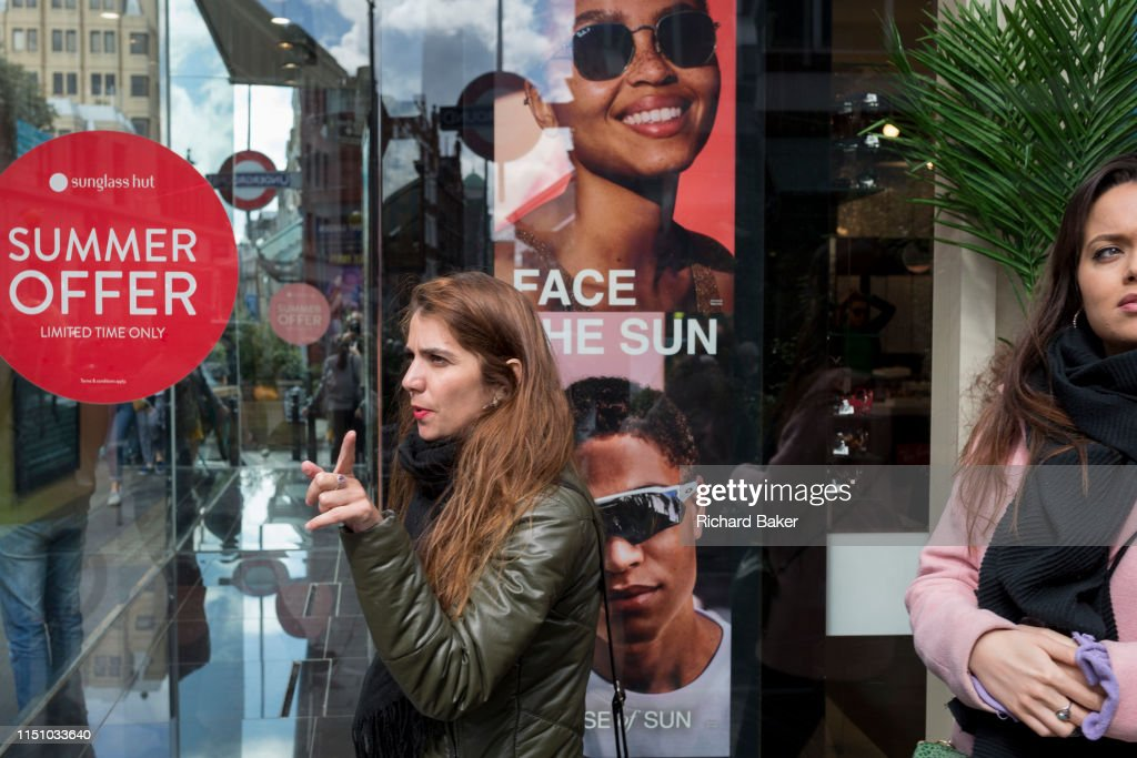 Sunglasses Shop Window And Passer-By : News Photo