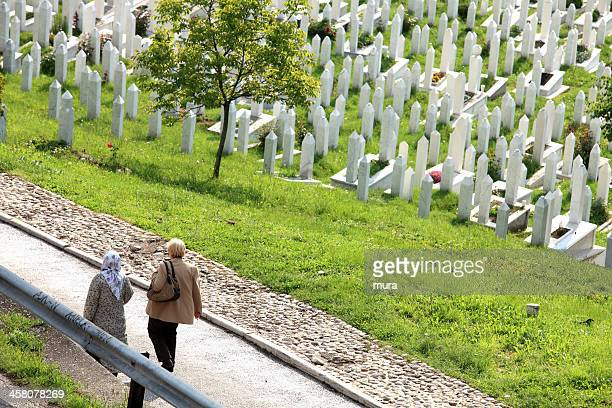 women passing by the war cemetery - moving past stock pictures, royalty-free photos & images