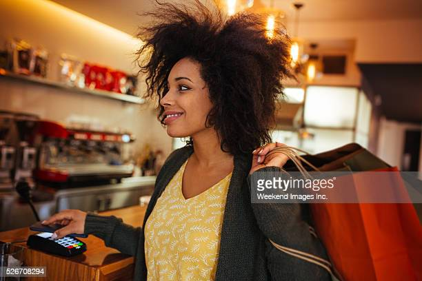 Women paying with the phone