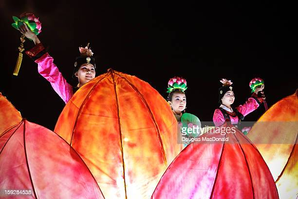 Women perform a dance on a parade float at a festival celebrating Buddha's birthday in Jeju City, South Korea on May 20th, 2012.