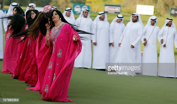 Women perform a traditional dance on the final day of the 2012 Dubai Ladies Masters Golf tournament on December 8 in the Gulf emirate of Dubai AFP...