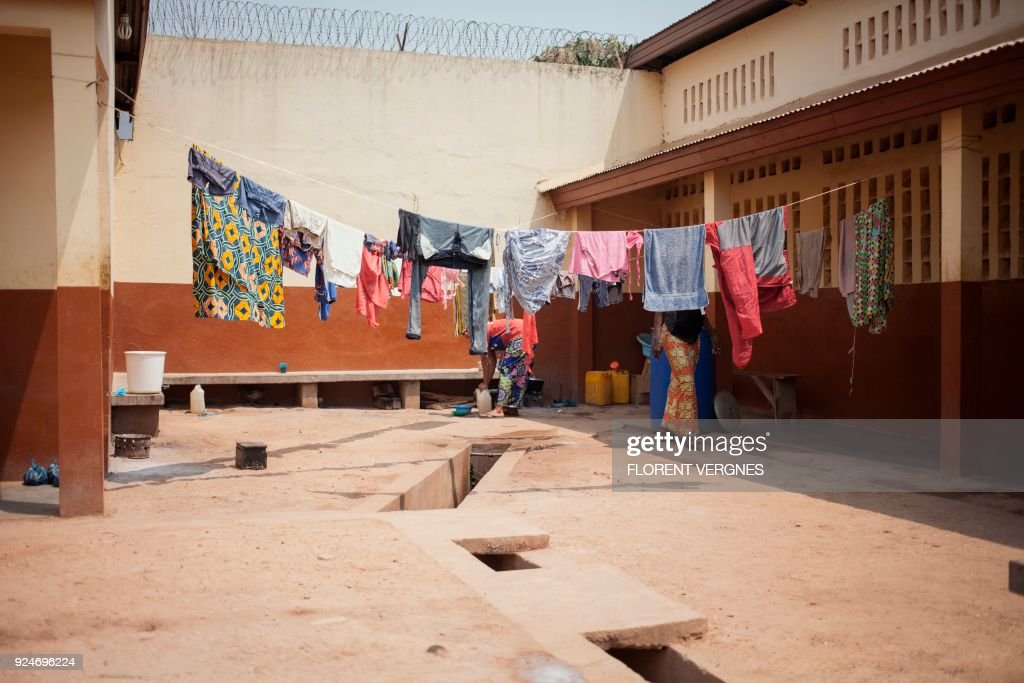Women perform daily tasks at the Bimbo Women's Prison in Bangui on