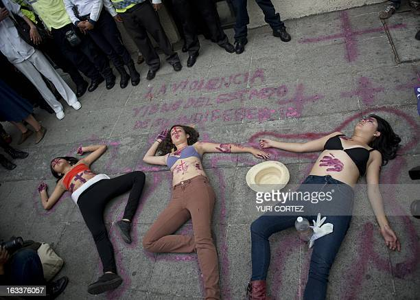 Women perform during a protest against violence in front of the Chihuahua State local goverment building in Mexico City on March 8 2013 in the...