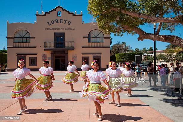 Women perform folklore dance at tourist office