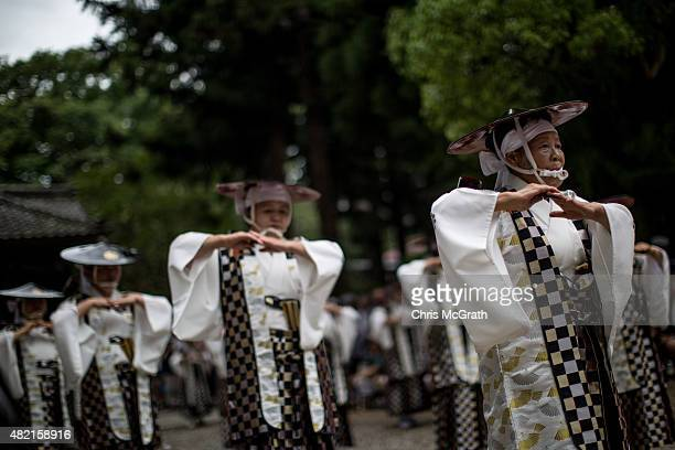 Women perform in traditional dress during a Samurai ritual at Nakamura Shrine on July 24, 2015 in Soma, Japan. Every summer the people of Fukushima...