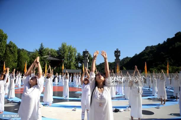 Women perform Kong Fu yoga at Laojun Mountain on July 7, 2017 in Luoyang, Henan Province of China. Miya Muqi, an actress in director Stanley Tong's...